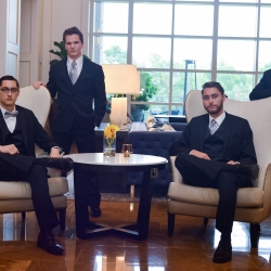 Groom poses with his groomsmen before his wedding at The Ballantyne Hotel