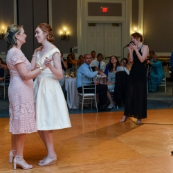 Bride dances with her mother in a sweet moment during her wedding reception coordinated by Magnificent Moments Weddings