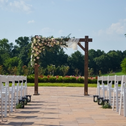 Ceremony arch covered in spring roses by Jimmy Blooms is the perfect backdrop for a spring wedding
