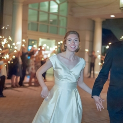 Bride and groom exit their reception through a sea of sparklers all captured by Georgestreet Photography