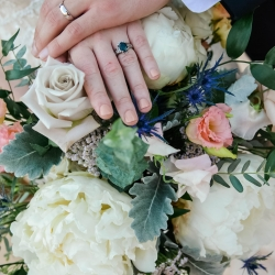Georgestreet Photography captures a detail shot of the bride and grooms rings and also shows off the stunning bridal bouquet created by Jimmy Blooms
