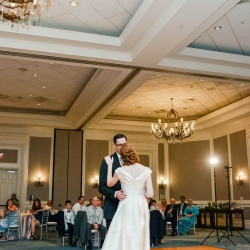 Bride and groom share a first dance to music from Split Second Sound during their spring wedding at The Ballantyne Hotel