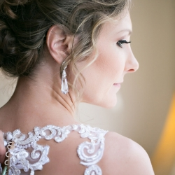 Curled updo and soft makeup by Be Pretty gives the bride a glowing look for her Uptown Charlotte wedding