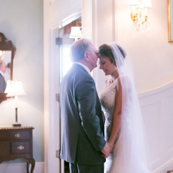 Bride and her father share a sweet moment captured by Old South Studios before her wedding ceremony at Belk Chapel