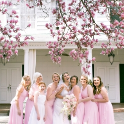 Bride and her bridesmaids share a laugh captured by Old South Studios before a wedding ceremony at Belk Chapel