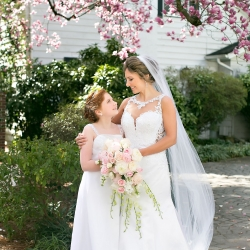 Bride poses with her flower girl before her stunning wedding ceremony at Belk Chapel in Uptown Charlotte