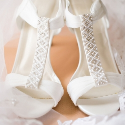 Old South Studios captures a stunning detail shot of a brides shoes and veil before she marries in Uptown Charlotte