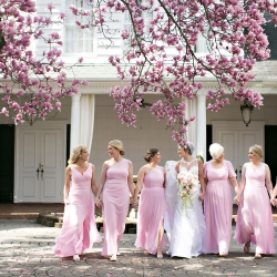 Old South Studios captures a bride with her bridesmaids wearing soft pink dresses before her wedding ceremony at Belk Chapel