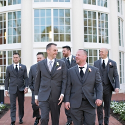 Groom poses with his groomsmen before his wedding at Belk Chapel