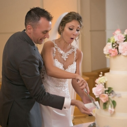 Bride and groom cut their stunning cake created by Kathy Allen Fine Cakes