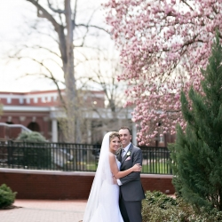 Bride and groom pose on the grounds of Queens University after their wedding reception at Belk Chapel