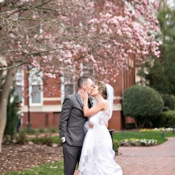Old South Studios captures a bride and groom embracing after exchanging vows at Belk Chapel in Uptown Charlotte