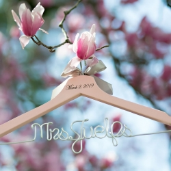 Custom hanger shows off a brides new last name before her wedding in Uptown Charlotte