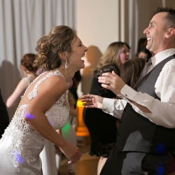 Bride and groom dance during their wedding reception to music provided by Split Second Sound
