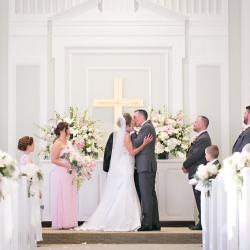 Bride and groom share a kiss after exchanging vows at Belk Chapel in Uptown Charlotte
