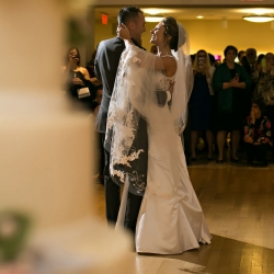 Bride and groom share a first dance to music provided by Split Second Sound during their wedding reception at Levine Museum of the New South