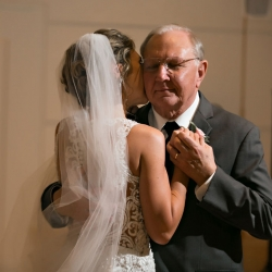 Bride shares a dance with her father during her wedding captured by Old South Studios