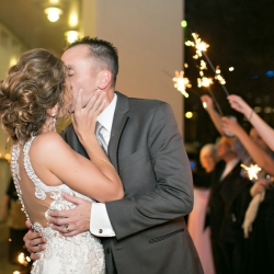 Old South Studios captures a bride and groom under a sea of sparklers after they Uptown Charlotte Wedding at Levine Museum of the New South