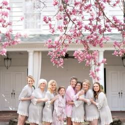 Bride poses with her bridesmaids as they getting ready for her Uptown Charlotte wedding coordinated by Magnificent Moments Weddings