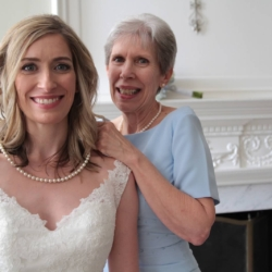 Smiling bride and mother of the bride on her wedding day