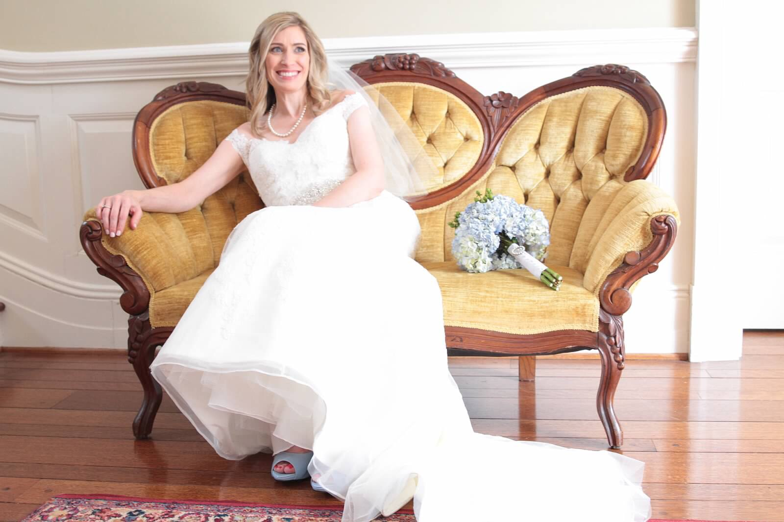 Bridal portrait in an antique yellow settee