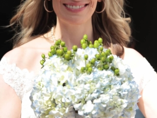 Beautiful bride with a blue hydrangea bouquet getting ready to walk down the aisle.
