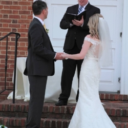 Pastor marrying a bride and groom.