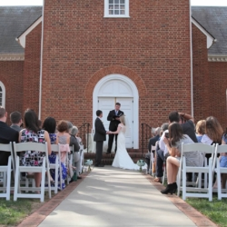 Pastor marrying a bride and groom at Forest Hill Church.