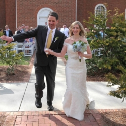 Bride and Groom dabbing at the end of the aisle.