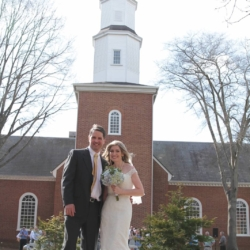 Bride and groom posing in front of the Forest Hill Church cathedral.