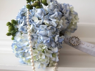 blue hydrangea bouquet with pearl necklace, bridal details at Forest Hill Church
