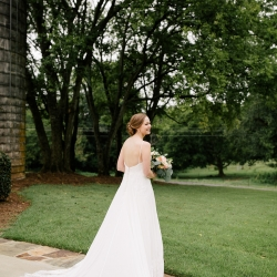 Cameron Faye Photography captures a bride and her beautiful lace train before her ceremony at The Diary Barn