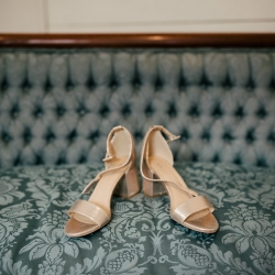 Cameron Faye Photography captures bridal shoes during a summer wedding at The Dairy Barn