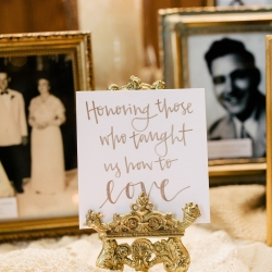Touching memorial table featured the couples passed loved ones and a memory candle in their honor all set by Magnificent Moments Weddings for a summer wedding