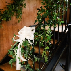 Buy the Bunch draped lush greenery through the Dairy Barn for a romantic vibe during a summer wedding