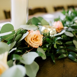 Cameron Faye Photography captures the details of soft roses and lush greenery for a summer wedding coordinated by Magnificent Moments Weddings
