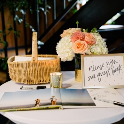 Guestbook featured pictures of the bride and groom arranged and set by Magnificent Moments Weddings