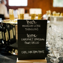 Cute bar menu signs let guests know their options during a wedding catered by Melanie Rowe Catering at The Diary Barn