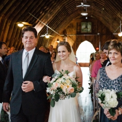 Bride is escorted down the aisle by her father during her moving wedding ceremony captured by Cameron Faye Photography