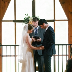 Bride and groom exchange vows during their summer wedding ceremony planned and coordinated by Magnificent Moments Weddings