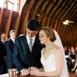 Bride and groom share in communion during their wedding ceremony at The Dairy Barn captured by Cameron Faye Photography