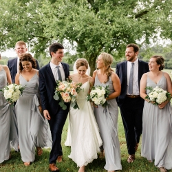 Bride and groom pose with their bridal party before their summer wedding in Fort Mill, South Carolina