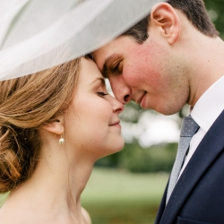 Bride and groom share a special moment during their summer wedding coordinated by Magnificent Moments Weddings