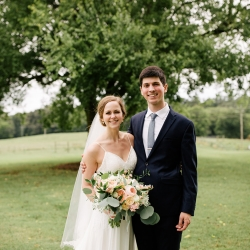 Bride and groom pose for Cameron Faye Photography during their summer wedding at The Dairy Barn