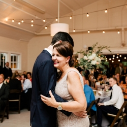 Groom shares a sweet dance with his mother to music provided by Carolina DJ Professionals during a summer wedding at The Dairy Barn