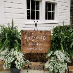 Custom welcome signed showed guests the love of the couple during a summer wedding captured by Cameron Faye Photography