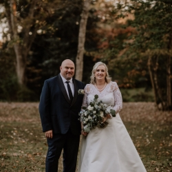 Bride and groom pose for Candle and Quill Photography during their fall wedding at Ritchie Hill