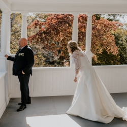 Brides surprises her groom during a first look captured by Candle and Quill Photography