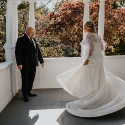 Bride shows of her stunning gown during a fun first look at Ritchie Hill