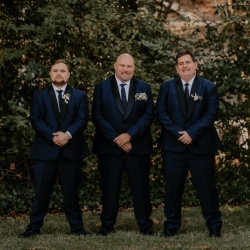 Groom poses with his grooms men for Candle and Quill before his wedding at Ritchie Hill